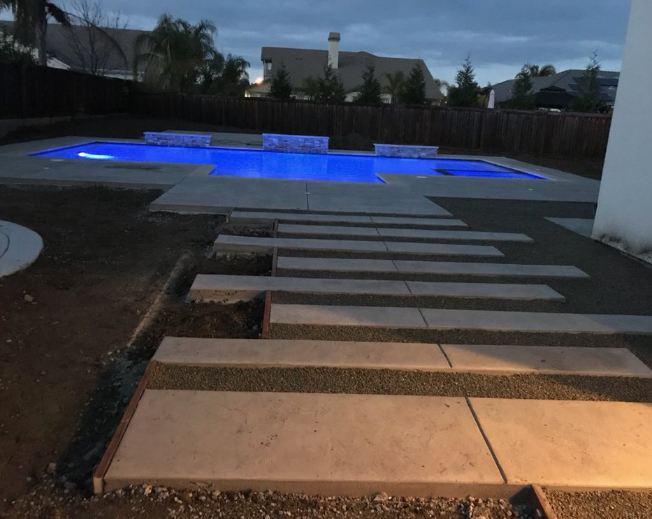 The photo shows the finished concrete slab work in Cerritos.