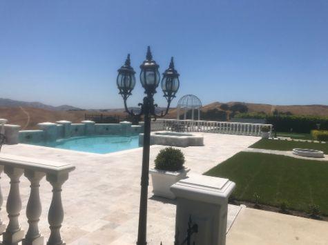 this picture shows the concrete pool deck cerritos ca